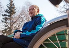 Free Eldely Man Sitting On A Bench Near His Bicycle In A City Park Royalty Free Stock Photo - 53377775