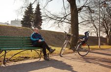 Free Elderly Man Sitting On A Bench Near His Bicycle In A City Park Stock Image - 53377861