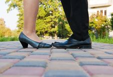 Feet Of The Man And Woman On A Romantic Date Royalty Free Stock Images