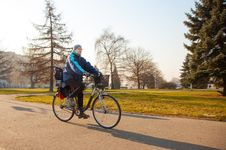 Free Elderly Man Riding A Bicycle Royalty Free Stock Image - 53378356