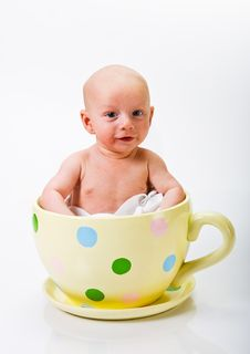 Free Baby In Yellow Spotted Cup Stock Image - 5341971