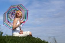 Young Charming Girl With Umbrella Against Blue Sky Stock Image