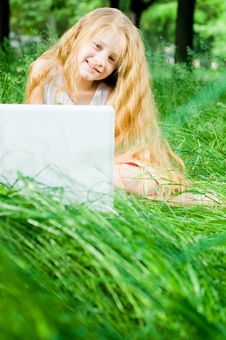 Free Smiling Little Girl With Laptop Royalty Free Stock Photos - 5346758
