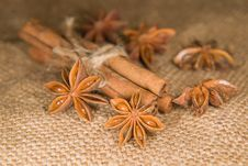 Star Anise And Cinnamon Sticks On Old Cloth Stock Images