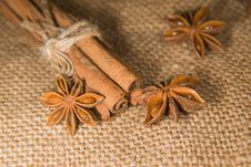 Star Anise And Cinnamon Sticks On Old Cloth Stock Image