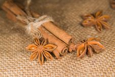 Star Anise And Cinnamon Sticks On Old Cloth Royalty Free Stock Image