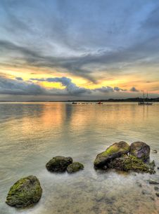 Free Sunset Over Rocky Beach Royalty Free Stock Photography - 5351757
