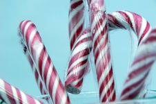 Free Candy Canes Isolated On Blue Stock Photography - 5352112