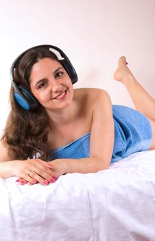 Free Beautiful Girl Smiling With Music Stock Photo - 5353090