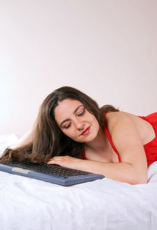 Free Pretty Girl Lying With A Keyboard Stock Images - 5353154