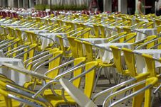 Free Yellow Chairs In Lines Royalty Free Stock Image - 5354916