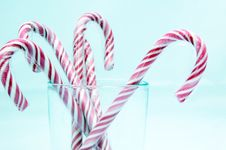 Free Candy Canes Isolated On Light Blue Royalty Free Stock Photography - 5354927