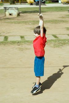 Free Boy Riding On Zip-Line Stock Photo - 5354970