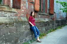 Teen Leaning Against Wall - Horizontal, Smiling Stock Image