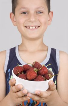 Free Boy And Plate With Strawberry Stock Photo - 5355570