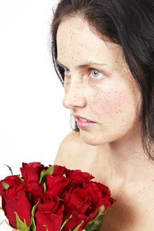 Beautiful Brunette Woman With A Bunch Of Roses Royalty Free Stock Photo
