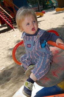 Baby On Merry-go-round Stock Images