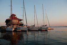 Sail Boats Lined Up At A Marina In A Lake Stock Photos
