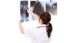 Young Female Doctor Isolated On White With X-ray Royalty Free Stock Photography