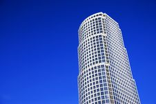 Lone Skyscraper On Against Blue Sky Stock Images