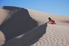 Free Young Girl Playing On Sand Dunes Stock Photos - 5358273
