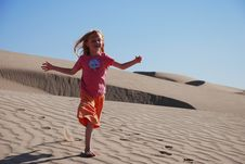 Free Young Girl Playing On Sand Dunes Royalty Free Stock Photo - 5358275