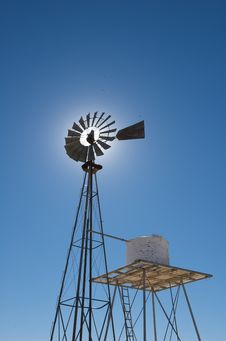 Free Rustic Windmill Against A Blue Sky Royalty Free Stock Images - 5358549