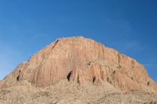 Free A Large Red Mountain On A Blue Sky Stock Photography - 5358732