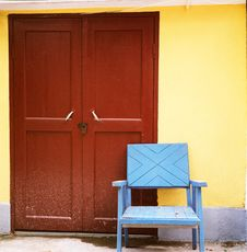 Free A Blue Chair Befor The Red Door Stock Photo - 5359100