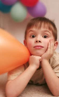 Free The Sight Of The Nice Boy And Is A Lot Of Balloons Royalty Free Stock Image - 5359456