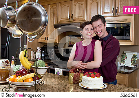 Free Couple Laughing In The Kitchen - Horizontal Stock Image - 5365561