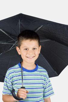 Free Young Boy Under An Umbrella Stock Photo - 5360910