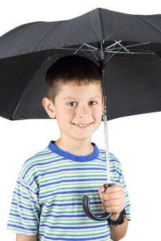 Free Young Child Under An Umbrella Stock Photos - 5360913