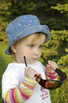Free Little Girl Plays With Glasses On Nature Stock Image - 5361731
