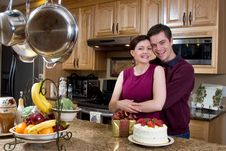 Couple Laughing In The Kitchen - Horizontal Stock Image