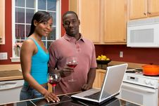 Free African American Couple Using Laptop In Kitchen Royalty Free Stock Photos - 5365608