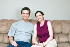 Couple On The Couch - Horizontal Royalty Free Stock Photos