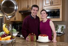 Free Couple In The Kitchen Exchanging Gifts Royalty Free Stock Photos - 5365968