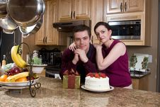 Free Couple Exchanging Gifts In Kitchen - Horizontal Royalty Free Stock Photography - 5366017