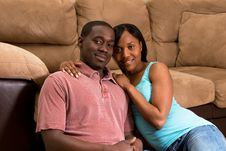 Free Couple Sitting Together By A Sofa- Horizontal Stock Photography - 5366052