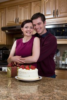 Free Couple Hugging In The Kitchen - Vertical Stock Photography - 5366132