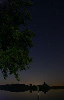 A Tree At The Lake At Night Royalty Free Stock Images
