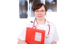 Free Young Female Doctor Holds Red Folder, X-rays Stock Photography - 5367682
