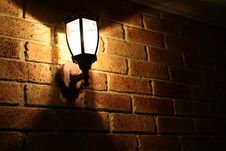 Free Lamp On A Brick Wall At Night Royalty Free Stock Images - 5369689