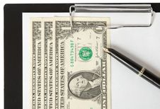Dollars, Pen And Paper Sheet On Binder Royalty Free Stock Image