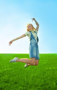 Beauty Young Woman Jump In Field Royalty Free Stock Photo