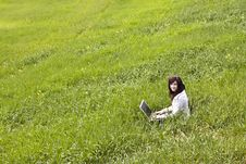 Free Woman Connected On The Grass Royalty Free Stock Images - 5372059