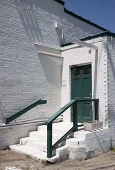 Green Door On White Brick Stock Image