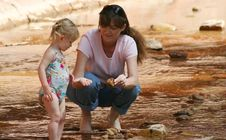 Free A Toddler And Woman Wade In A Creek Royalty Free Stock Photography - 5374147