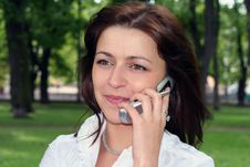 Woman Is Talking By Mobile Royalty Free Stock Image